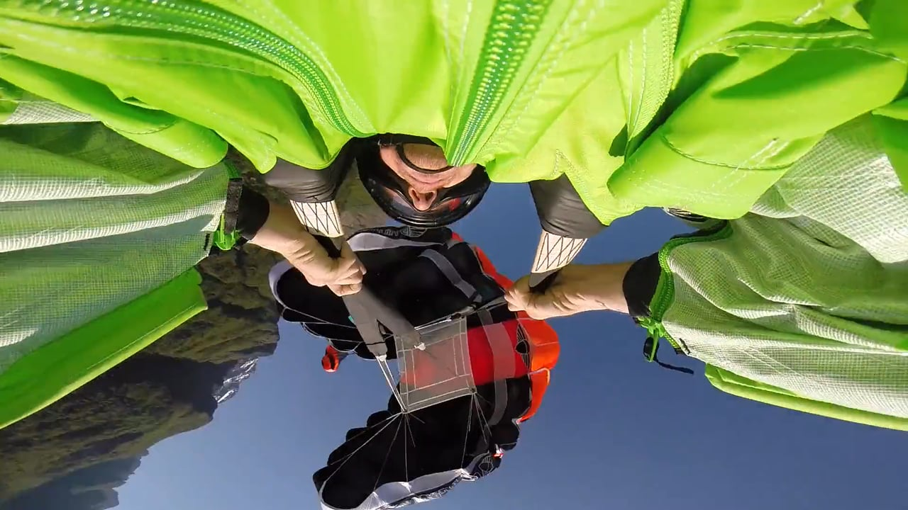 Wingsuit Riser Control and Parachute Openings